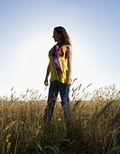 Hispanic woman standing in field