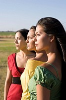 Row of multi-ethnic women in sunlight (thumbnail)