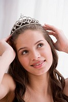 Hispanic teenaged girl wearing tiara