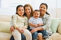 Hispanic family on sofa