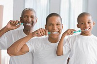 African American grandfather, father and son brushing teeth (thumbnail)