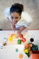 African American woman chopping vegetables