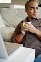African American man holding coffee mug