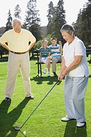 Senior Asian woman playing golf