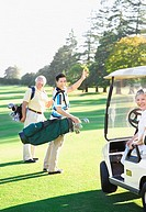 Asian family on golf course