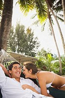 Multi-ethnic couple laughing on beach