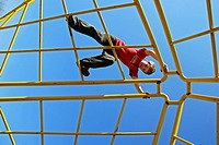 Boy, 7 years, climbing, Cologne, NRW, Germany