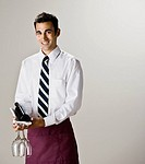 Indian waiter holding bottle of wine