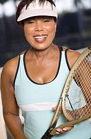 Portrait of a senior woman with a tennis racquet