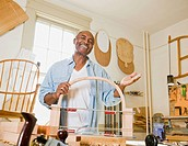 Senior African American man in woodworking shop (thumbnail)