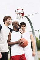 Smiling men with basketball