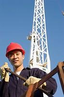 Asian male construction worker wearing hardhat
