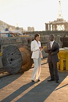 African American businesspeople on commercial pier