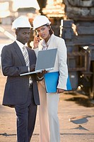 African American businesspeople wearing hardhats