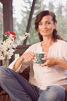 Mature woman holding coffee mug