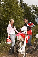 Couple with motocross bike