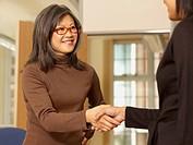 Asian businesswoman shaking hands