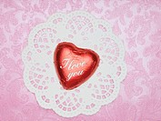 Chocolate heart on top of paper doily
