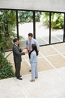 Businesspeople talking in a lobby