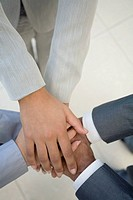 Multi-ethnic businesspeople's hands in huddle