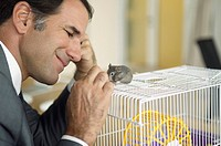 Businessman with gerbil