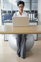 Woman sitting on fitness ball