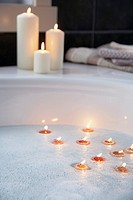 Tealights and votive candles in bathroom