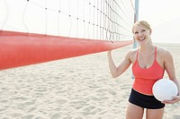Woman standing near volleyball net
