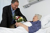 Husband visiting wife in the hospital
