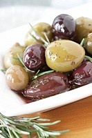 Black and green olives with rosemary