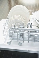 Dishes and eating utensils in dishwasher