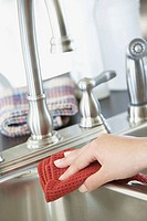 Woman wiping sink