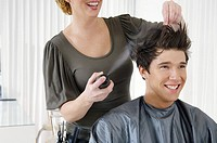 Hairstylist using hairspray