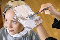 Hairstylist dyeing hair