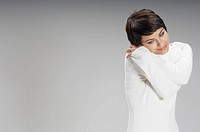 Young woman hugging self (thumbnail)