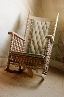 An old rocking chair in a Bodie residence, CA, USA