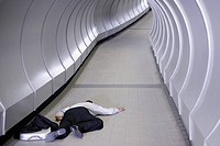 Businessman passed out in corridor
