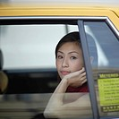 Businesswoman sitting in taxi