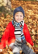Young boy outdoors looking at camera