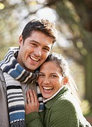 Couple outdoors embracing and laughing