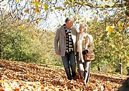 Couple outdoors walking in a park