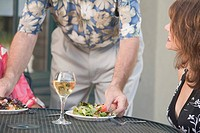 Man serving salad