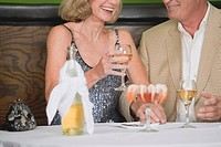 Mature couple with wine and shrimps in restaurant