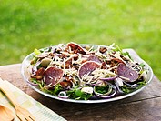 Salami salad with mushrooms, cheese and olives