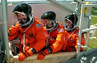 03/19/2002 __ __ STS_110 crew members sit in the slidewire basket, part of emergency egress equipment on the pad. From left are Mission Specialists St...