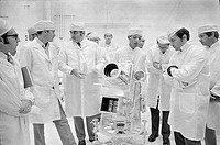 George Carruthers, center, principal investigator for the Lunar Surface Ultraviolet Camera, discusses the instrument with Apollo 16 Commander John You...