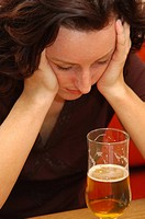 frustrated, young woman drinks alcohol