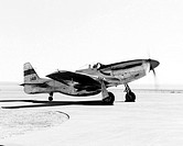 This photograph shows a NACA research pilot running up the engine of the F_51 Mustang on the taxiway adjacent to Rogers Dry Lake at the NACA High_Spee...