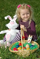 girl with Easter nest in meadow