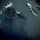 Volcanic, mountainous La Palma, covering 280 square miles 725 square kilometers, dominates this east_looking, low_oblique photograph. The large calder...